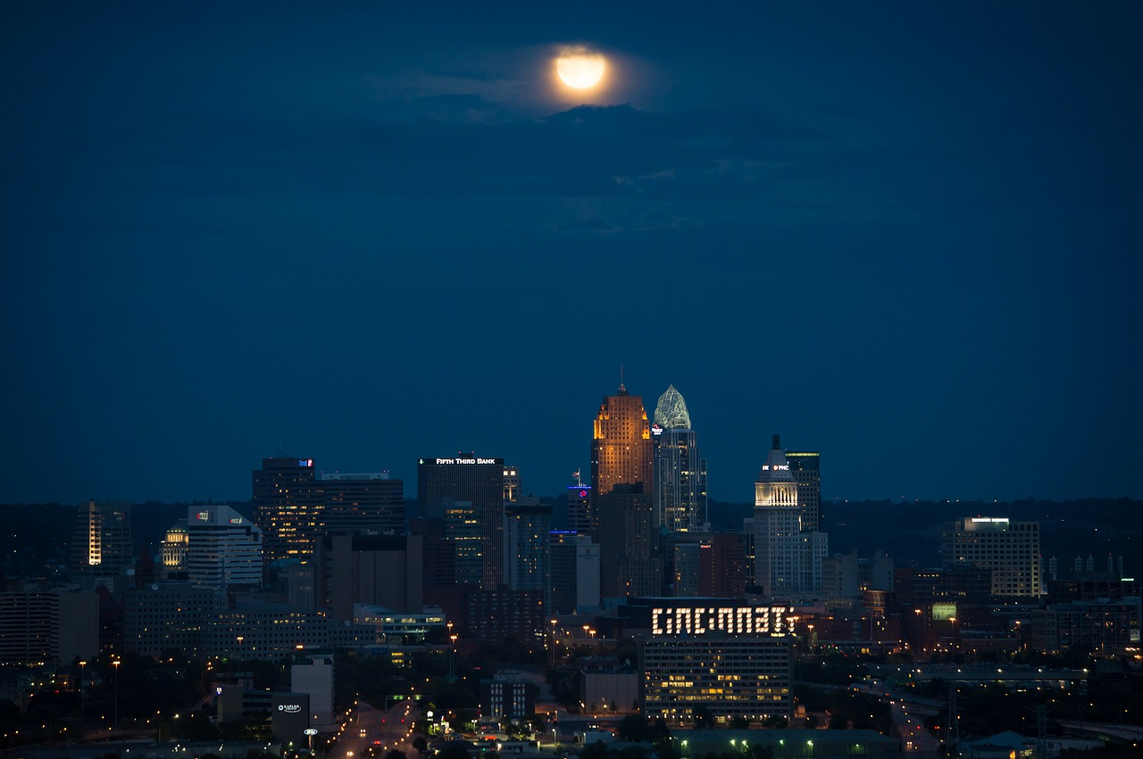 Downtown Cincinnati At Night With Moon Overhead