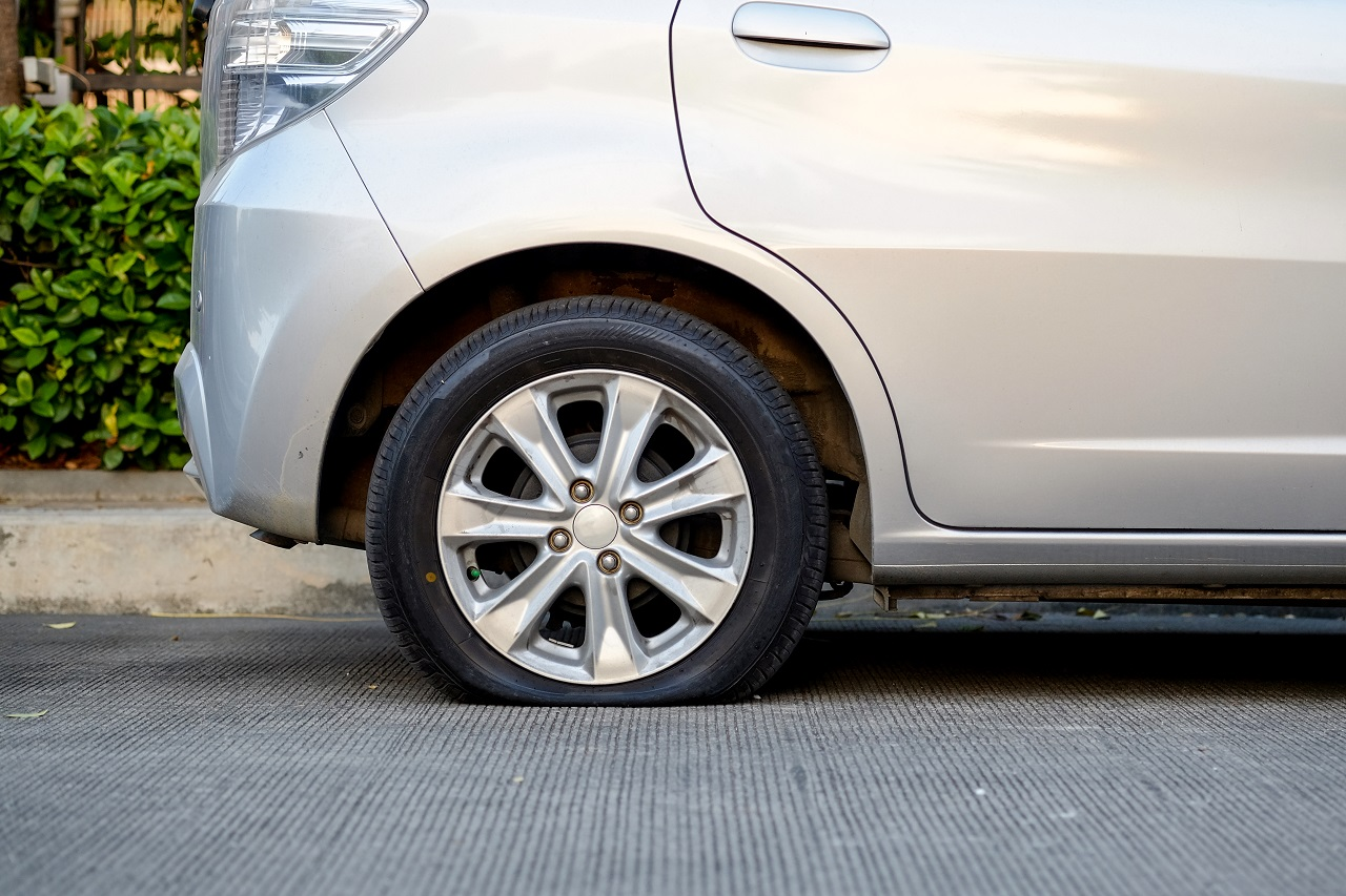 Small Compact Car Needs Flat Tire Service