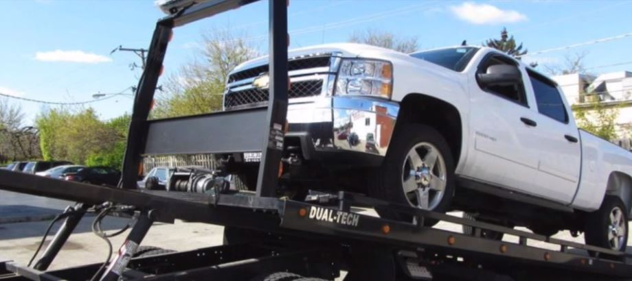 Flatbed Tow Truck Loading A White Pickup